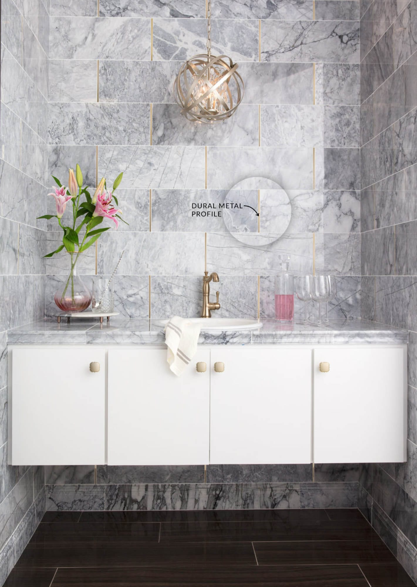 Dural metal profiles are a glamorous way to layer with marble.