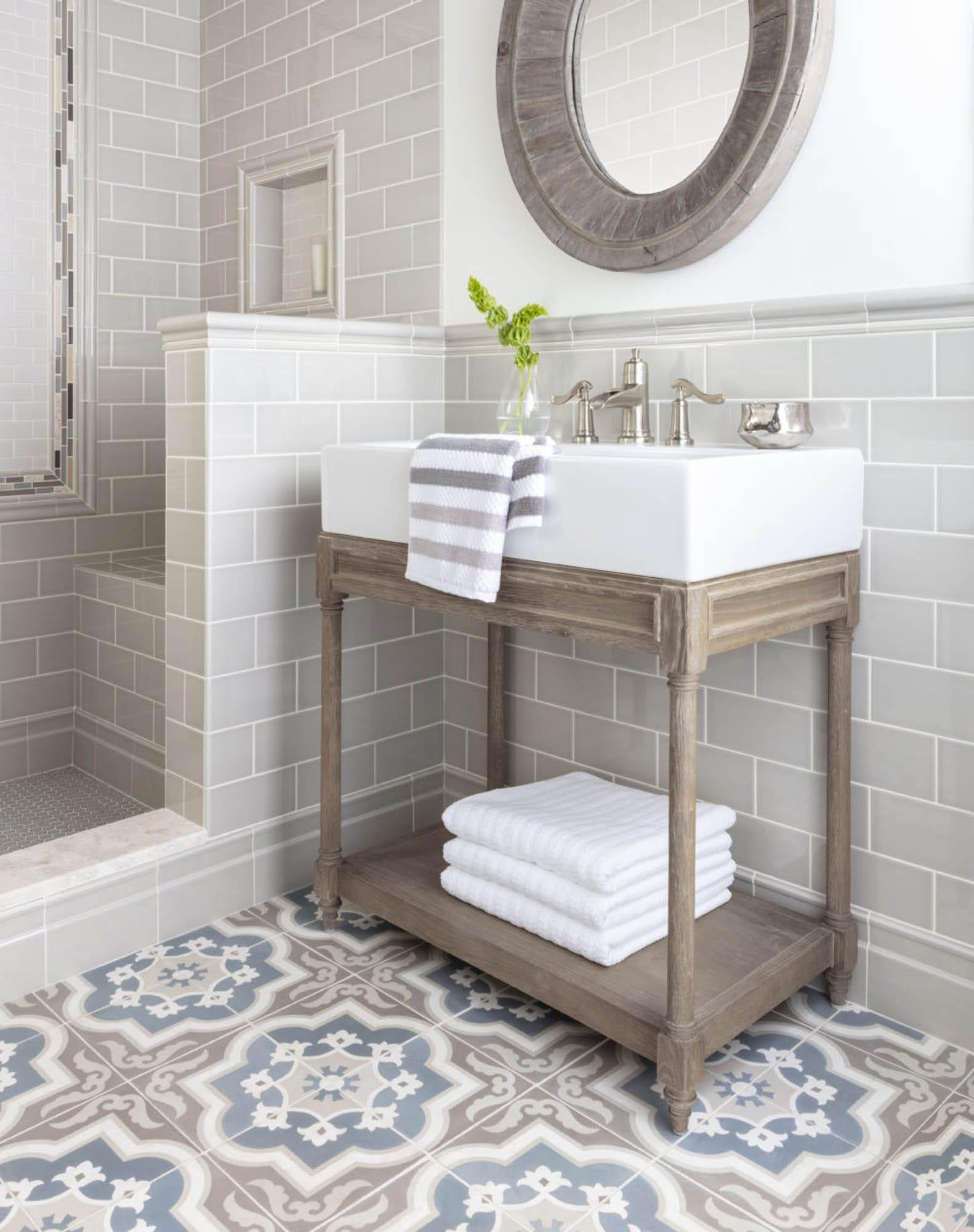 A cool, grey modern farmhouse bathroom