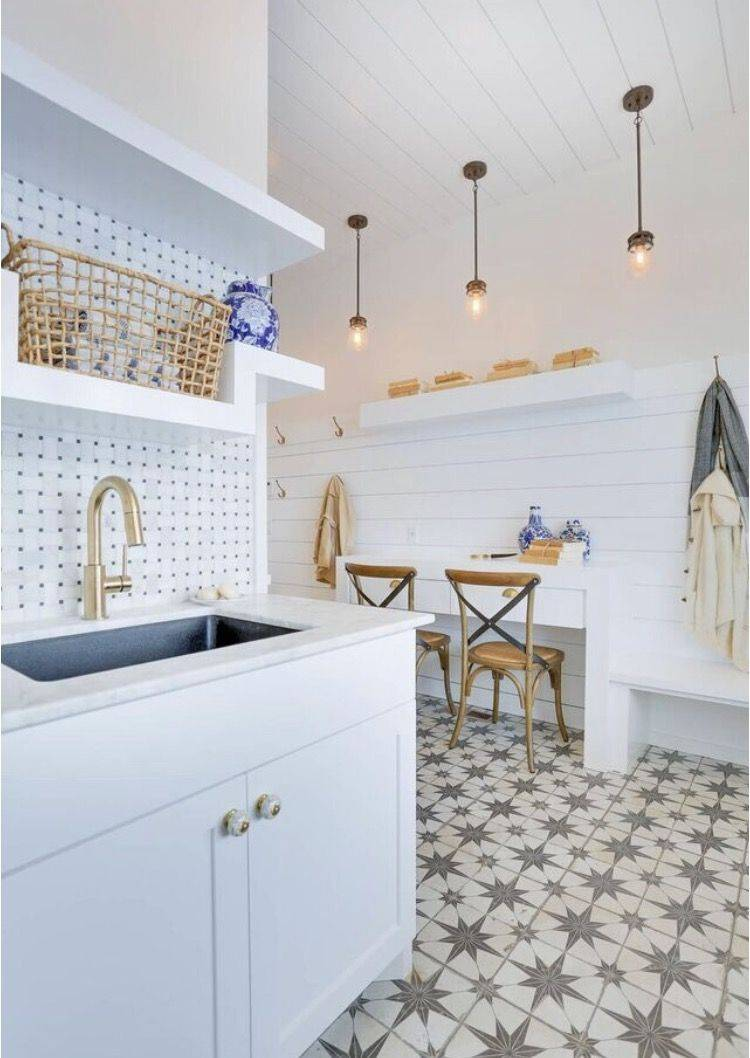 White painted cabinets and a handmade-look floor