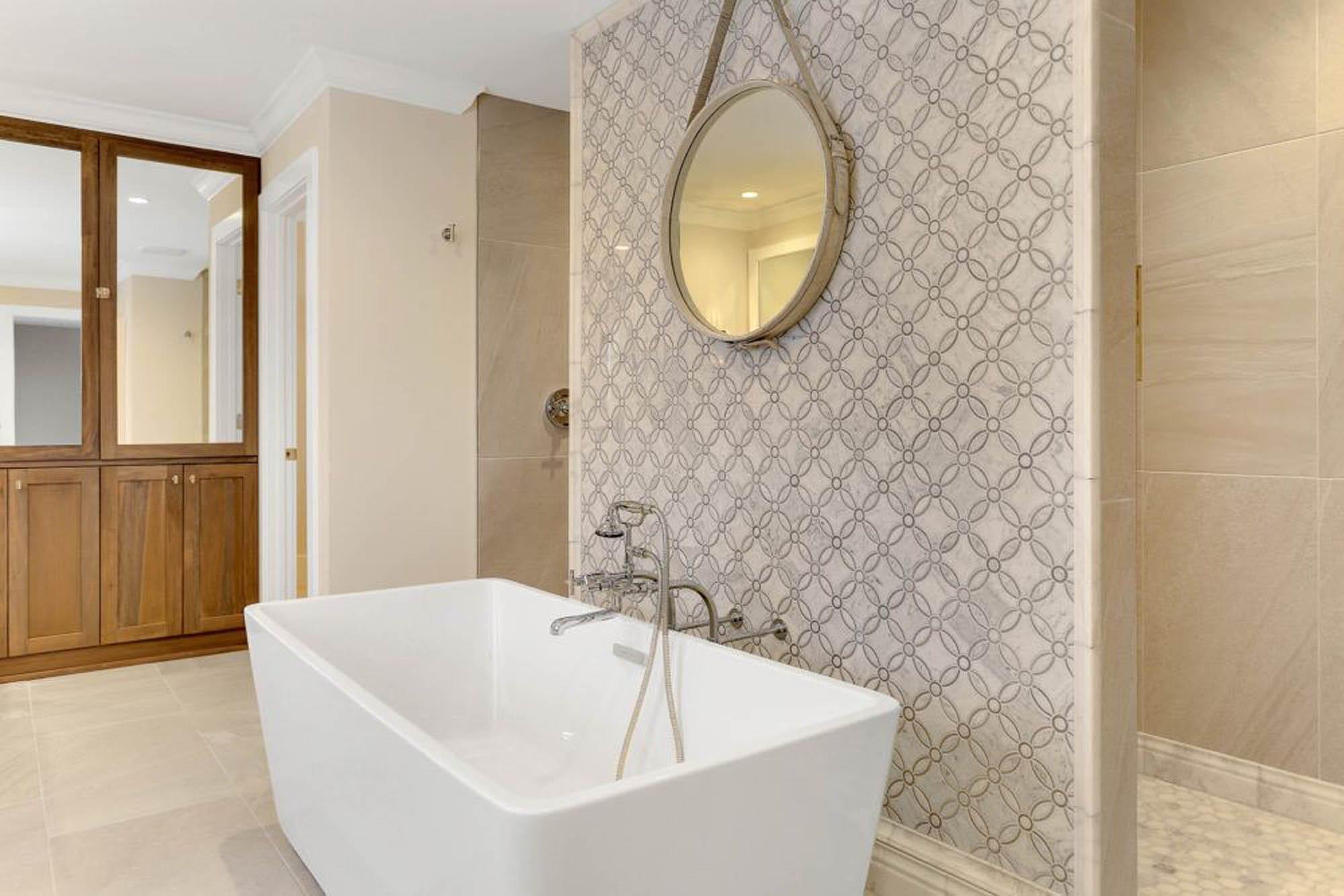 Beautiful bathroom with mosaic tile and bathtub