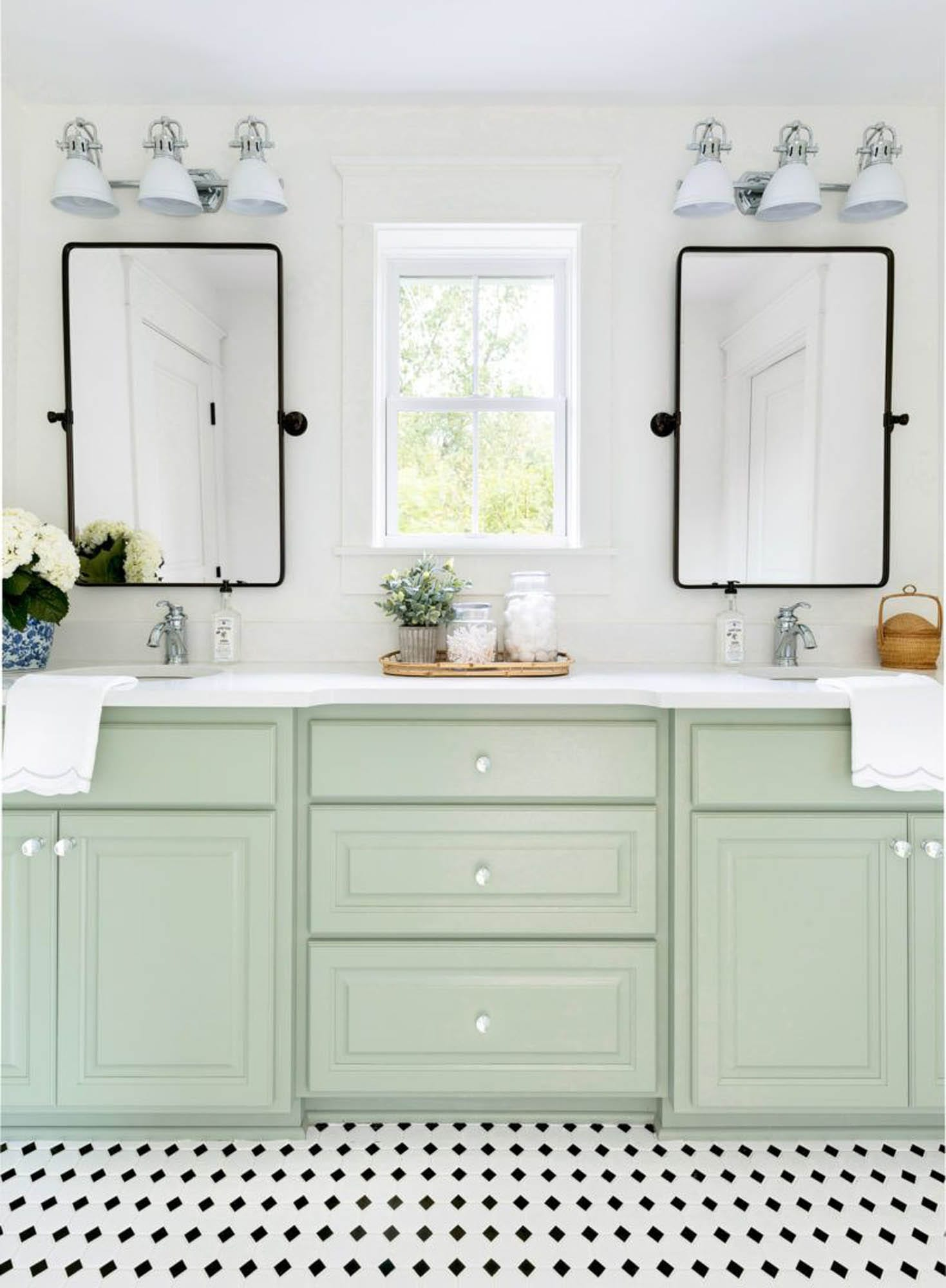 Bathroom with pale green cabinetry