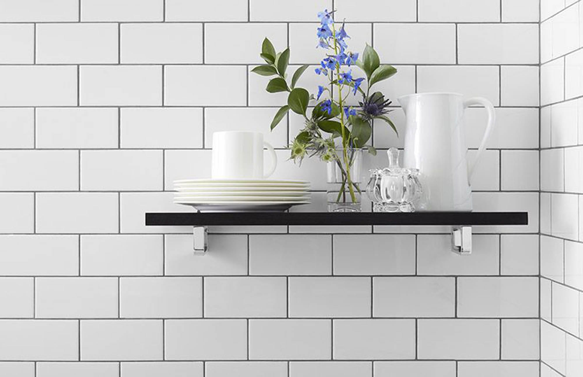 shelf with flowers against tile