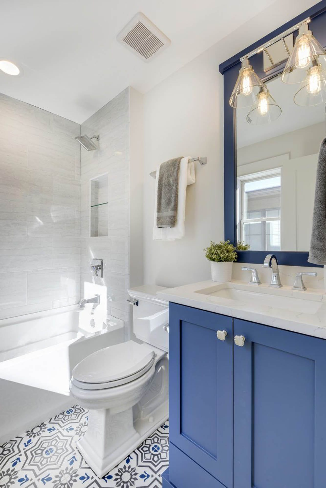 Bathroom with blue vanity cabinet
