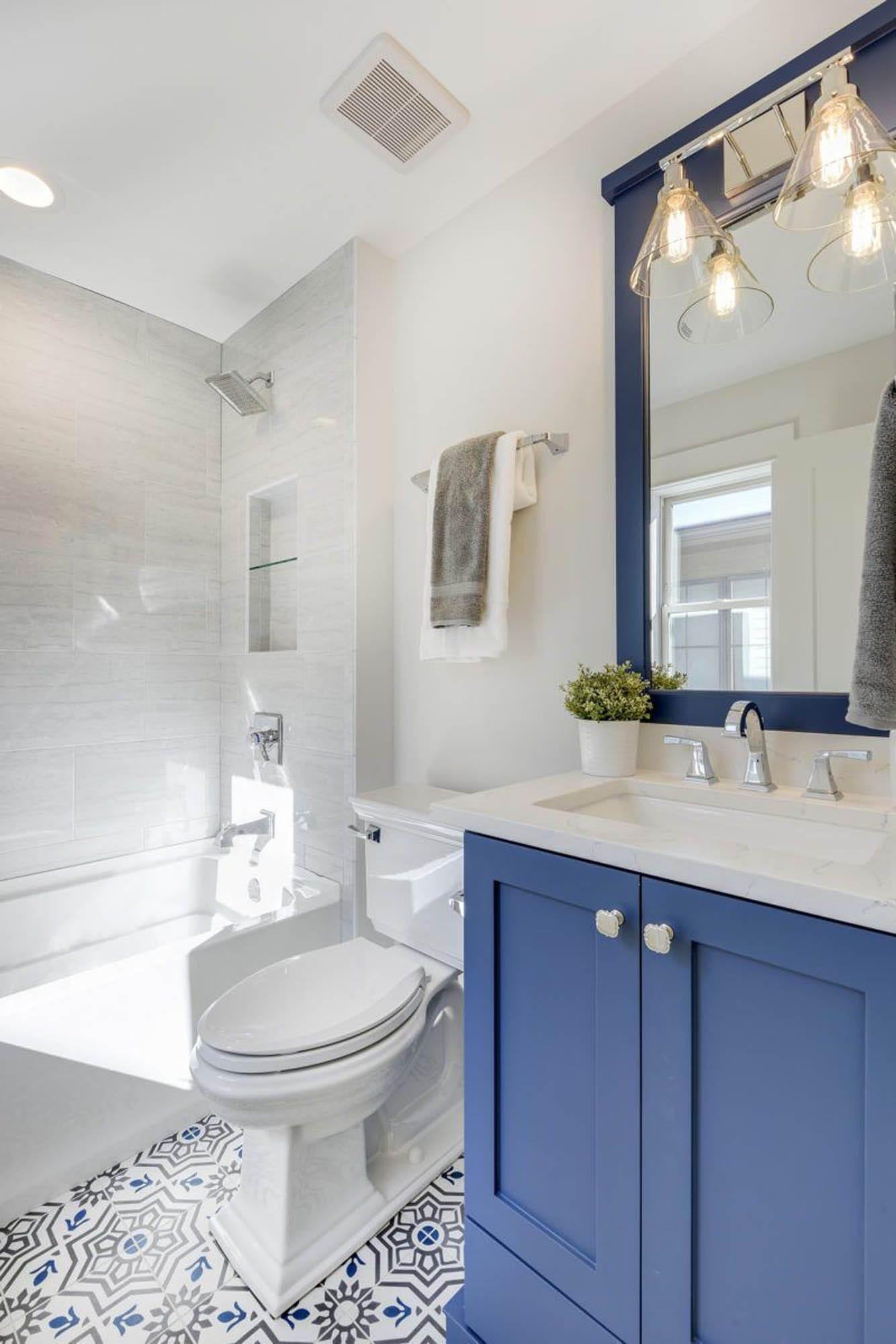 Bathroom with blue vanity cabinet