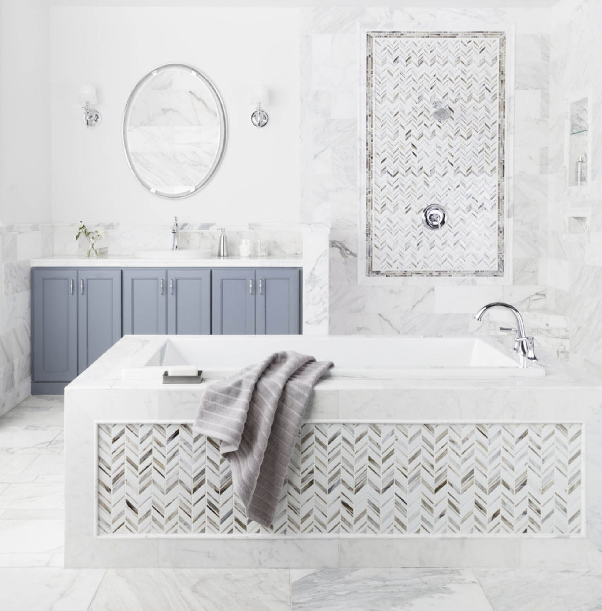 Marble bathroom with blue cabinet