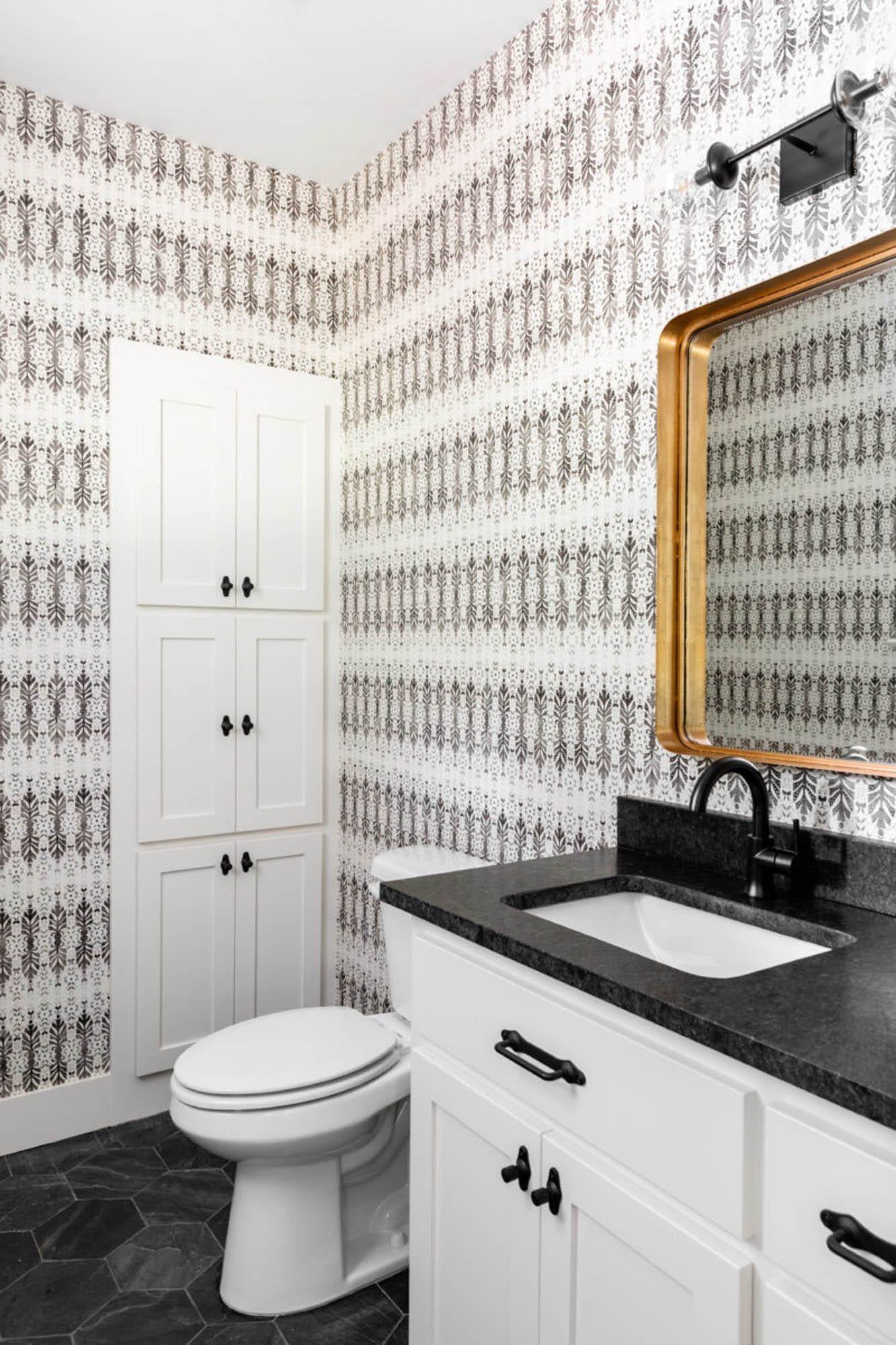 Glamorous bathroom with wallpaper