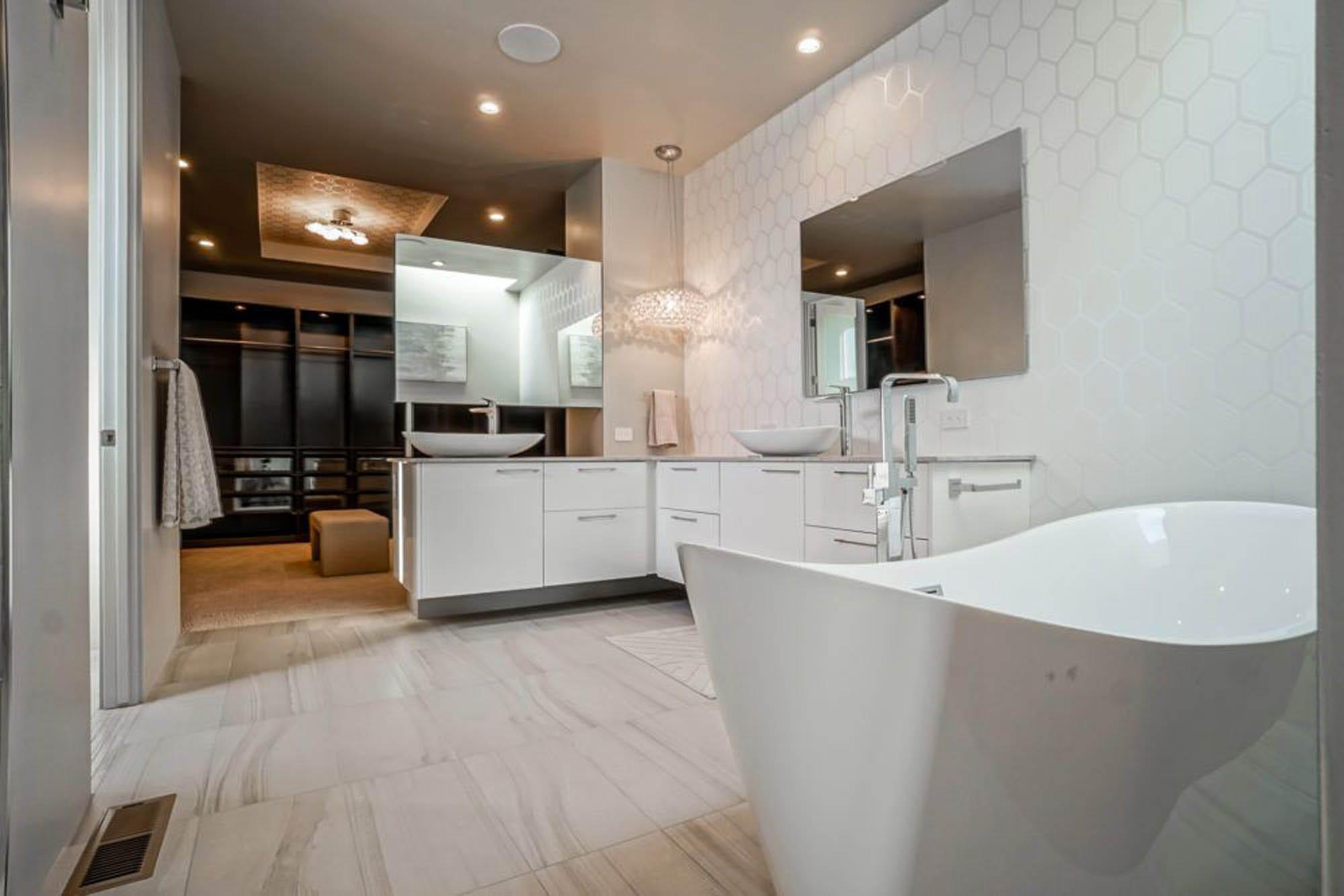 Spacious white tiled bathroom