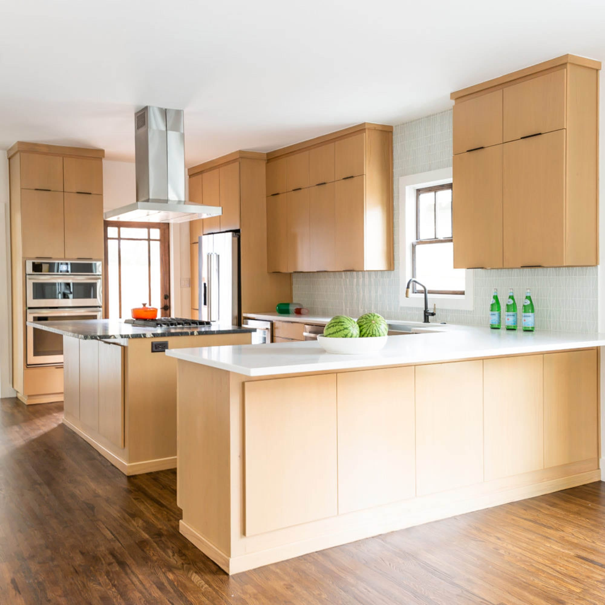Warm wood and white tile backsplash kitchen