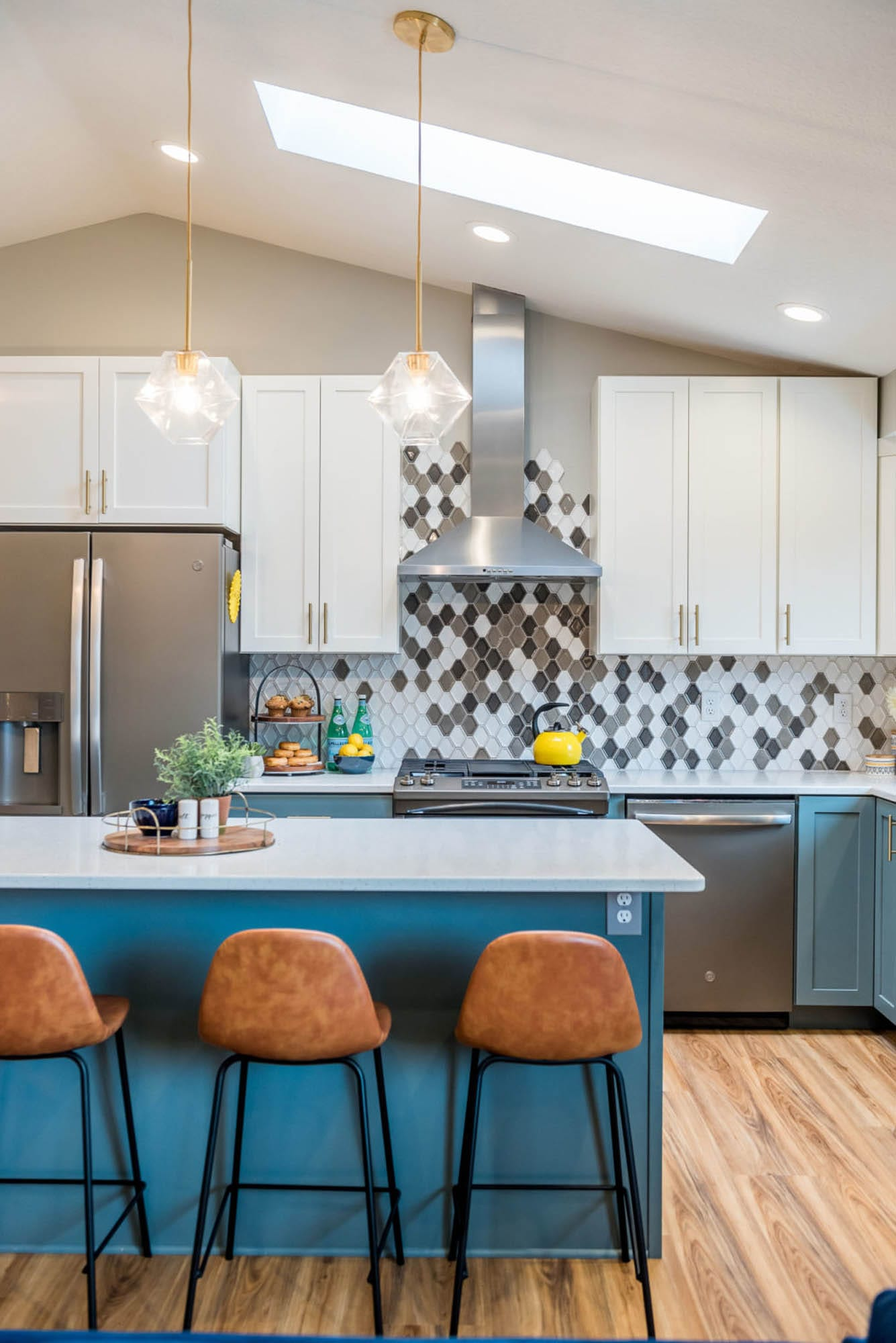 Blue cabinets and tile mosaic