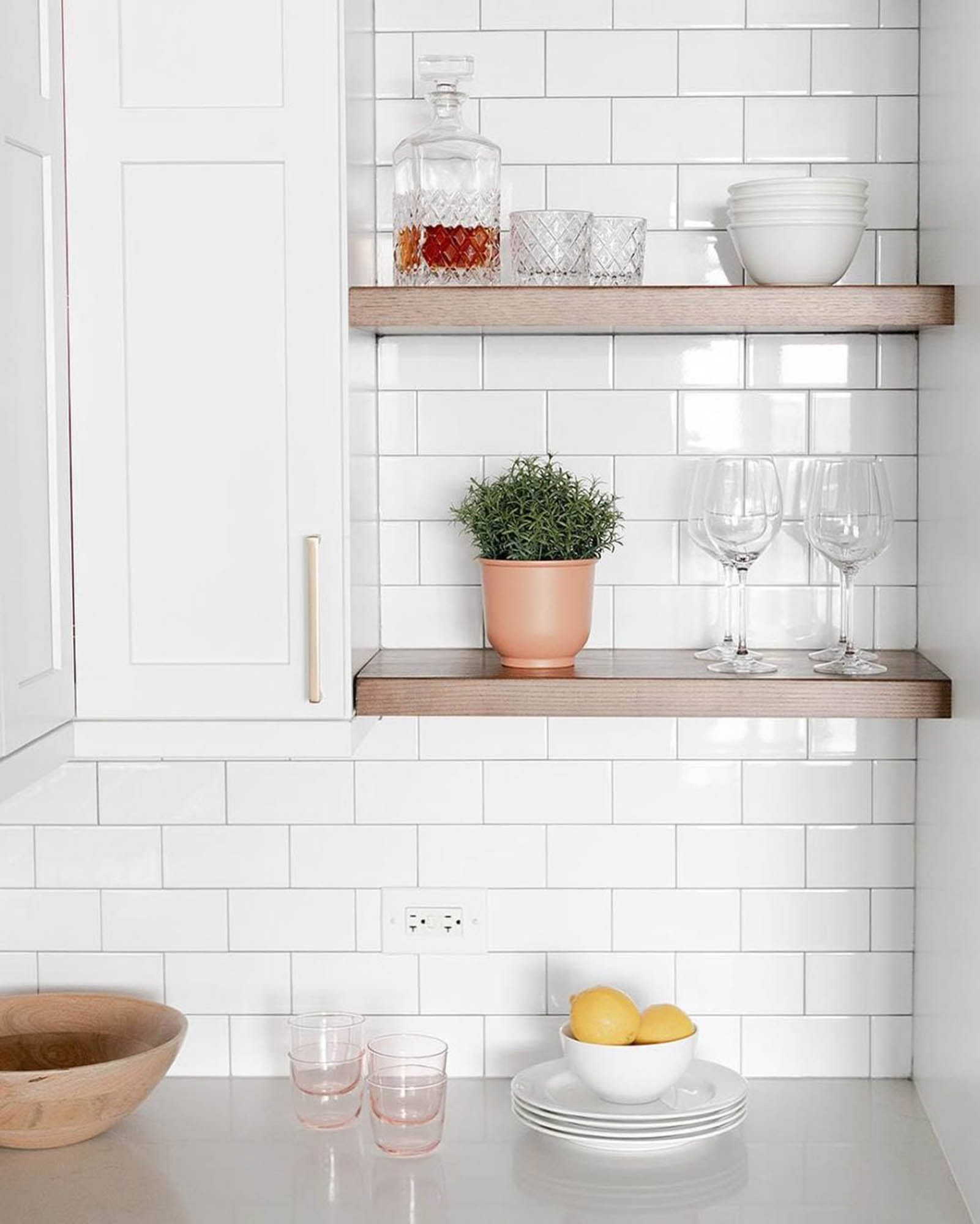 White subway tile and open shelving