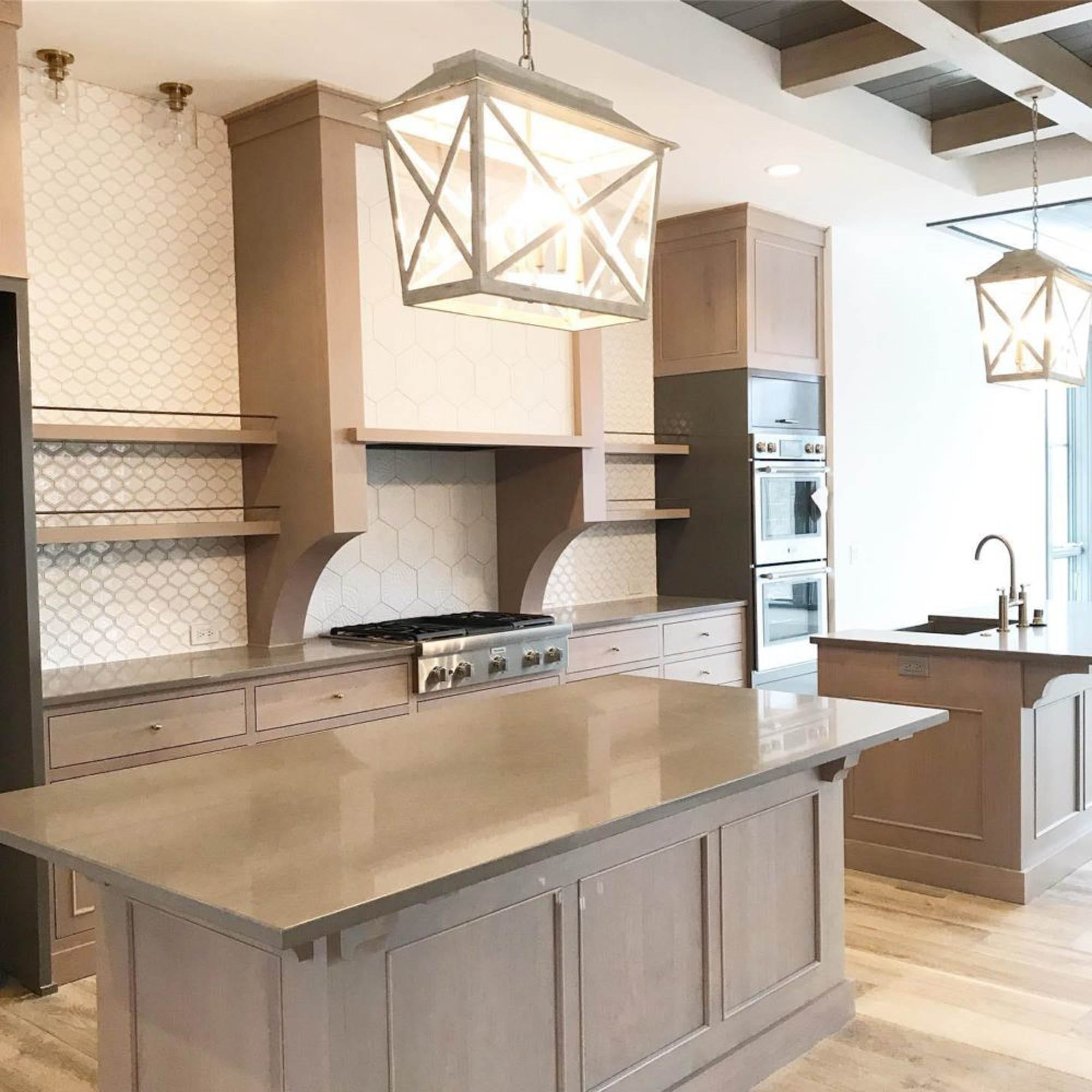 French farmhouse kitchen with two islands