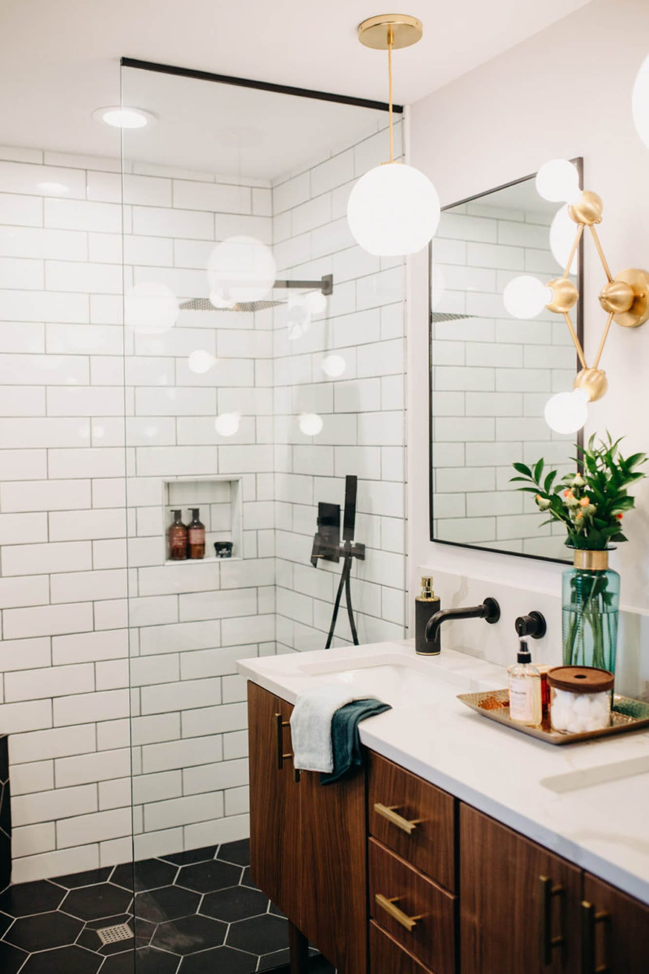 White subway and black hexagon bathroom tile