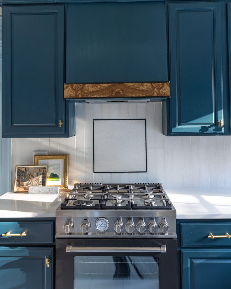 kitchen blue cabinet white backsplash