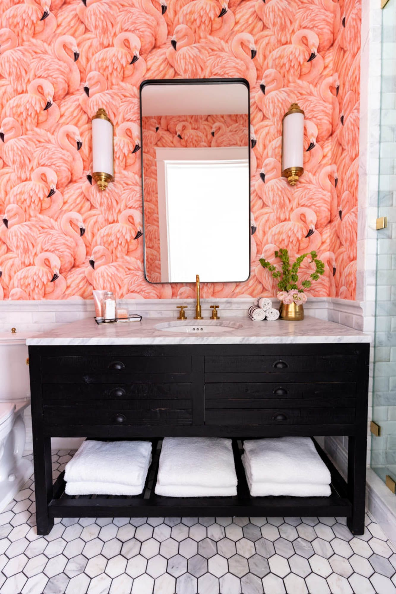 Flamingo wallpaper and white marble bathroom