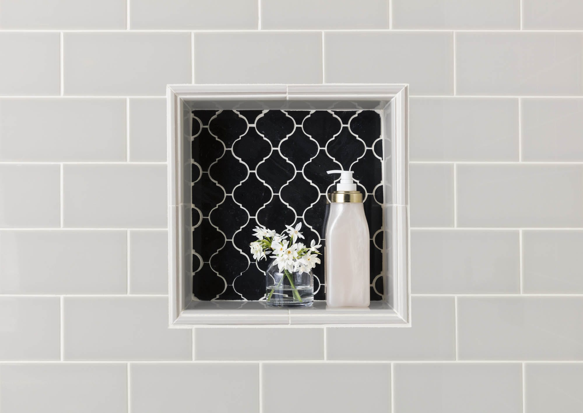 Glossy finish grey subway tile and nook