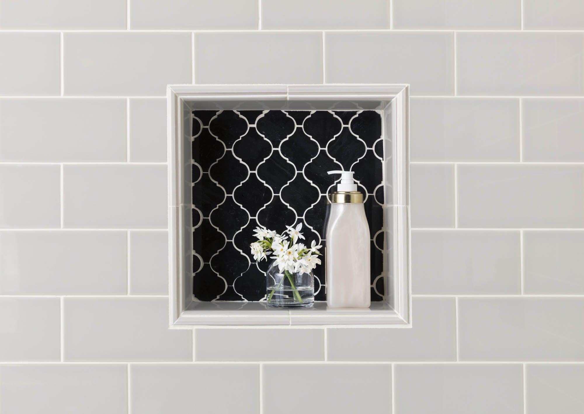 Glossy finish grey subway tile and nook