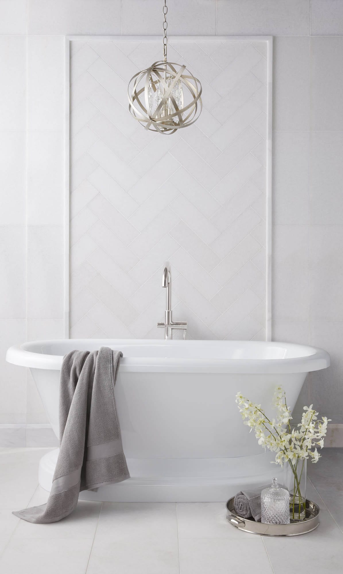 Honed white marble and bathtub