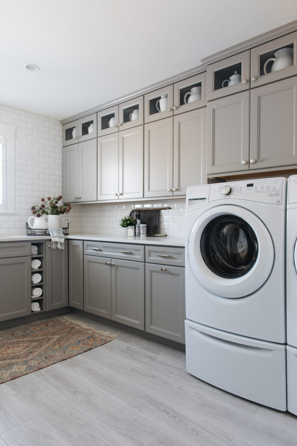 Greige transitional laundry room