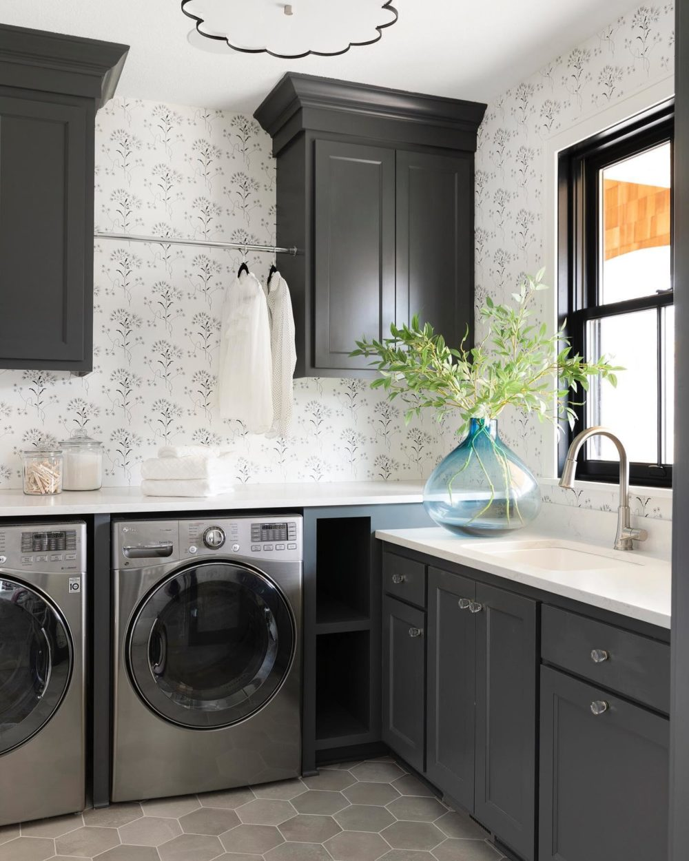 Floral wallpaper and tile floor laundry room