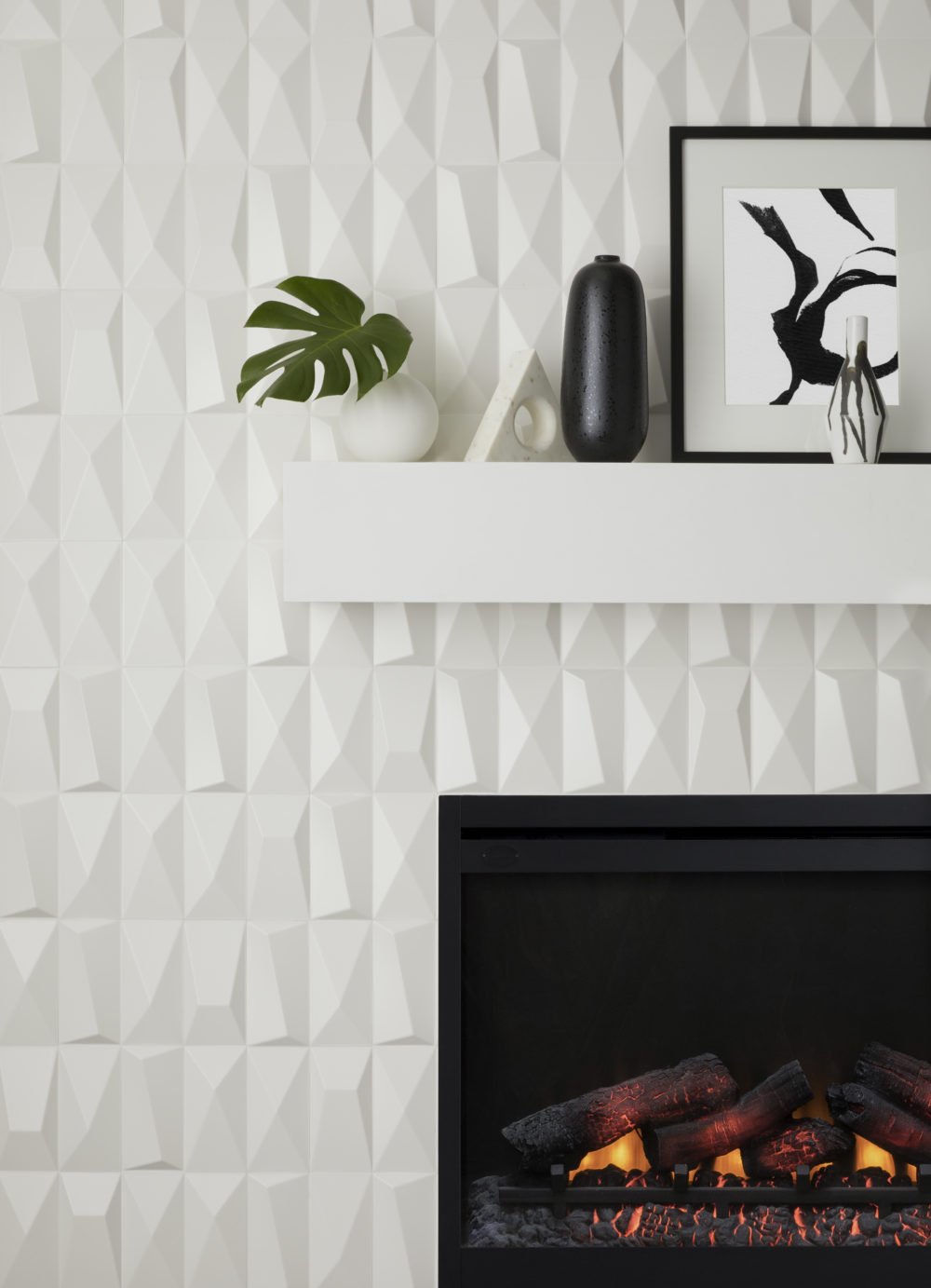 white geometric sculptural fireplace tile