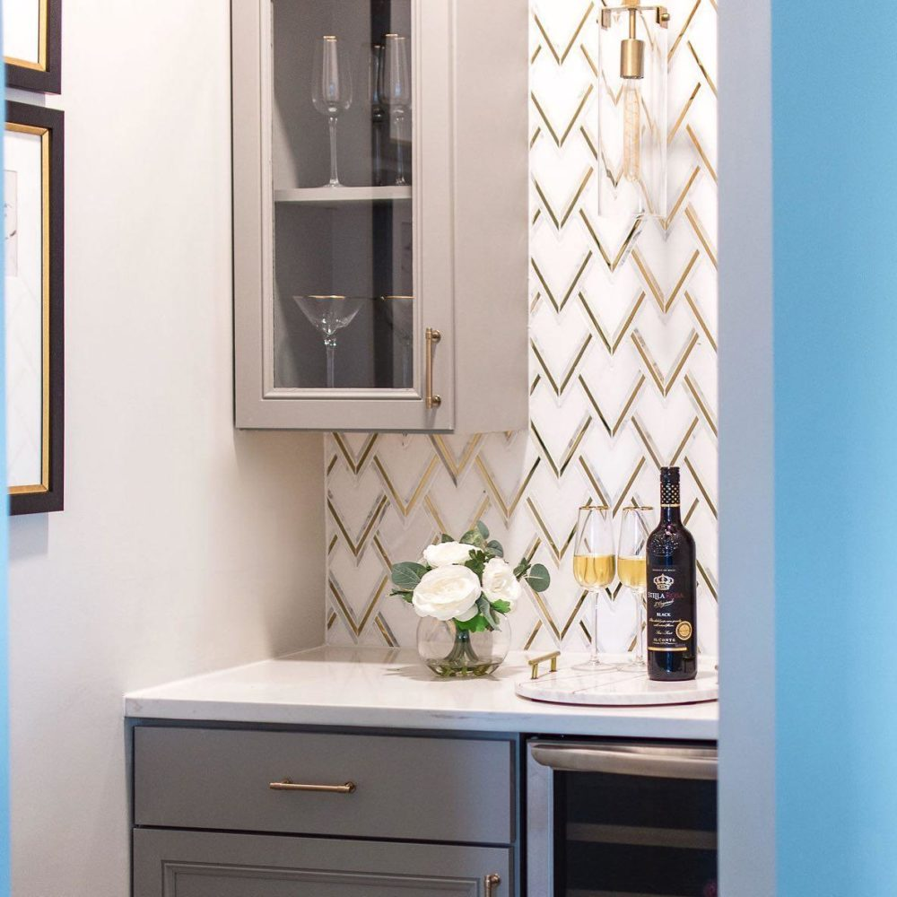 gold and marble mosaic tile bar