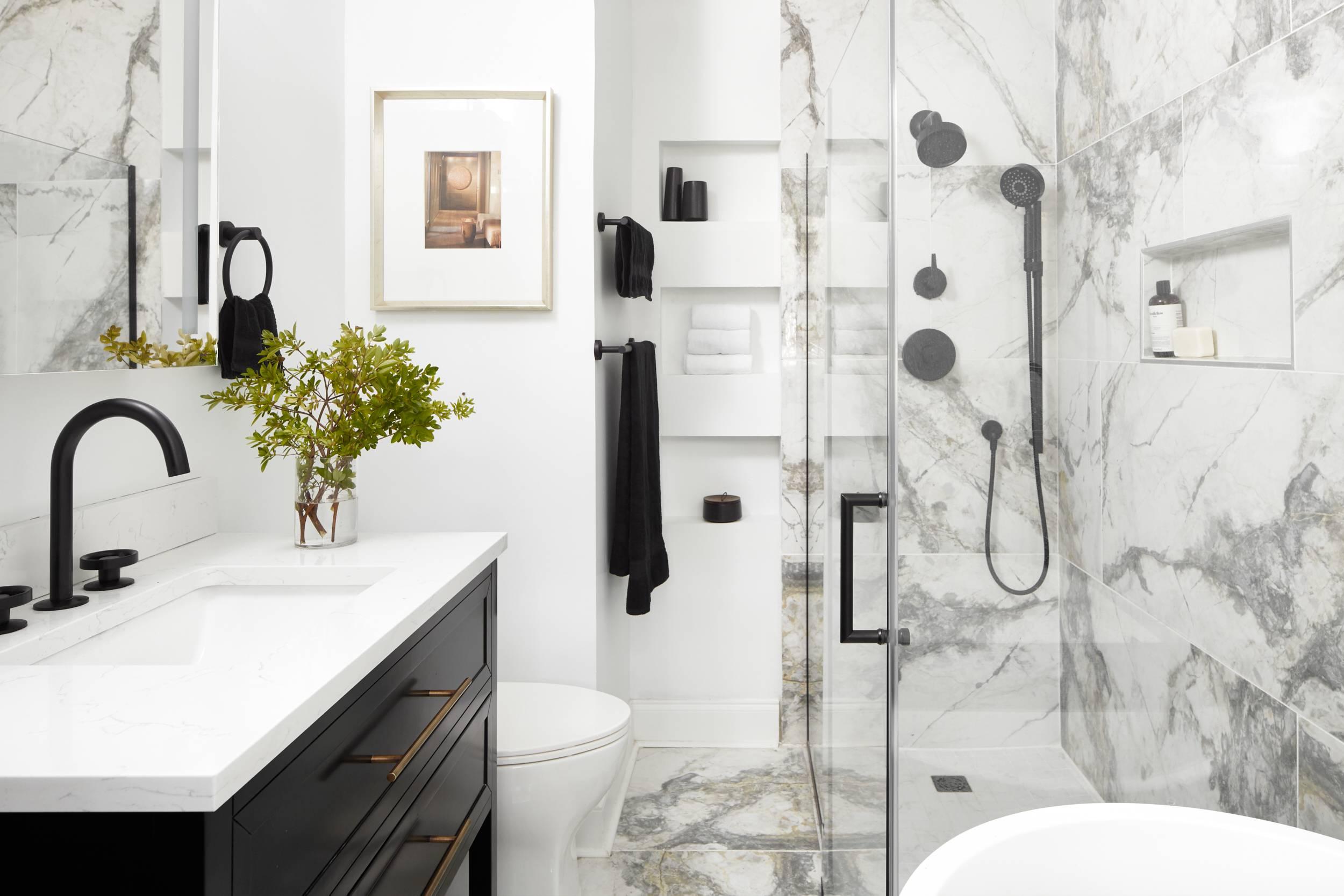 white modern bathroom with marble-look tile and shower backsplash