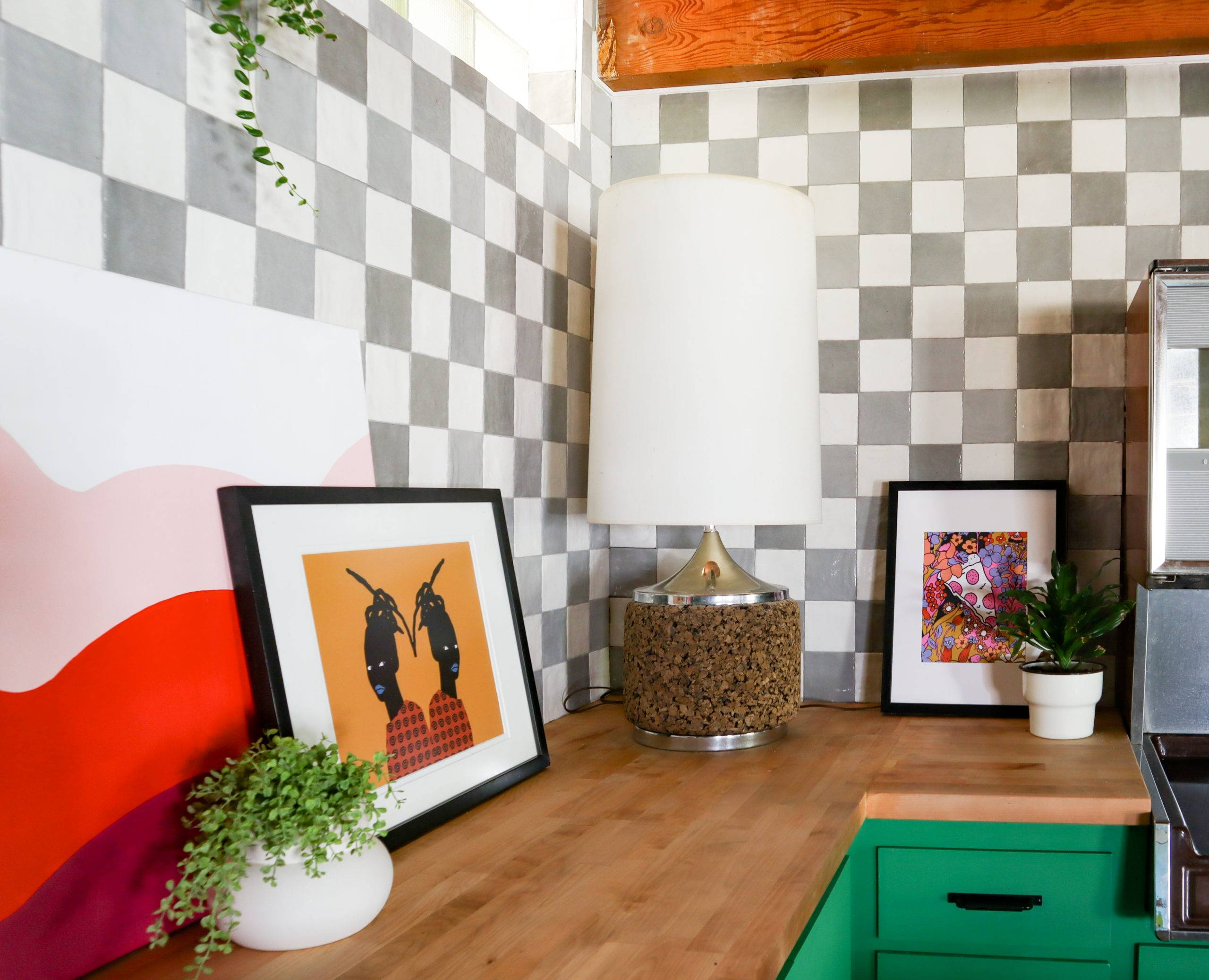 white and grey checkerboard tile backsplash with green cabinets