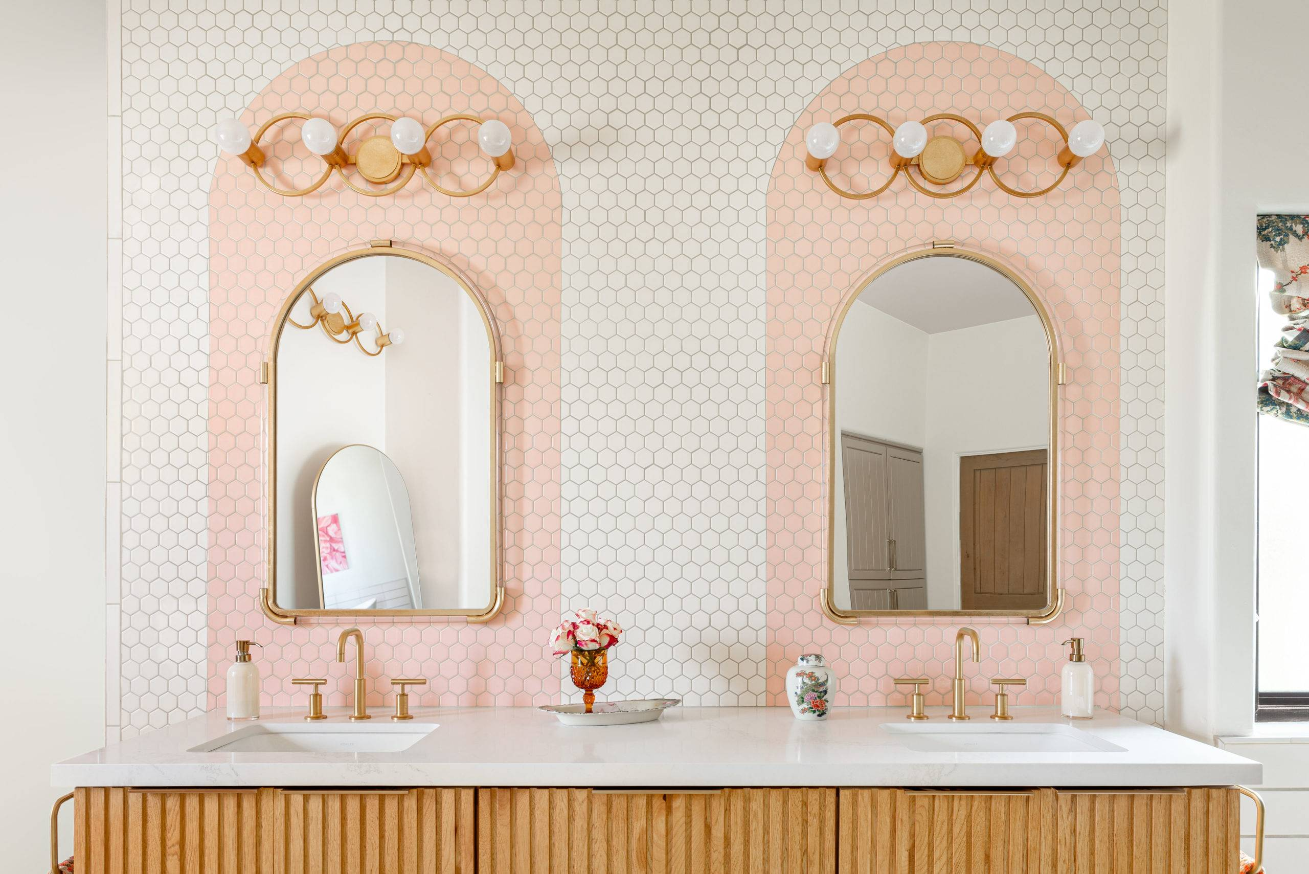 white and pink bathroom tiled backsplash with arches