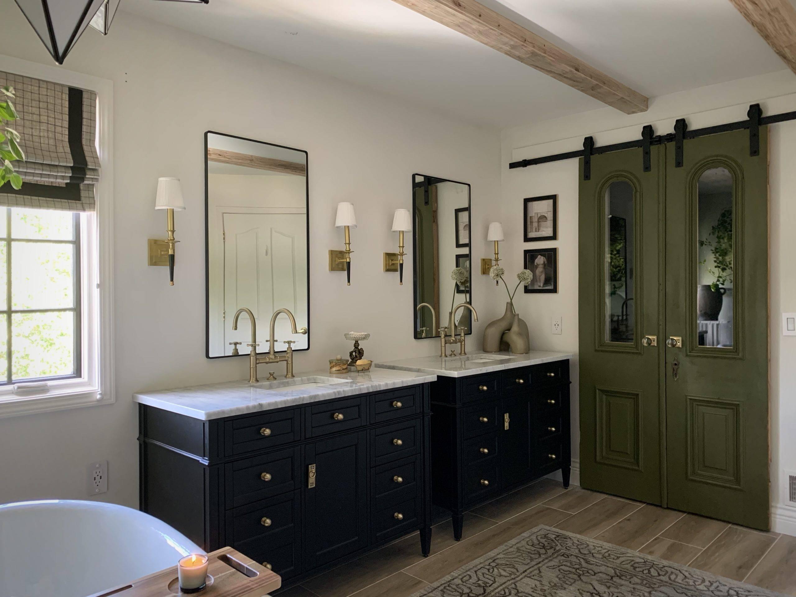 modern primary bath with black vanities and olive green sliding door