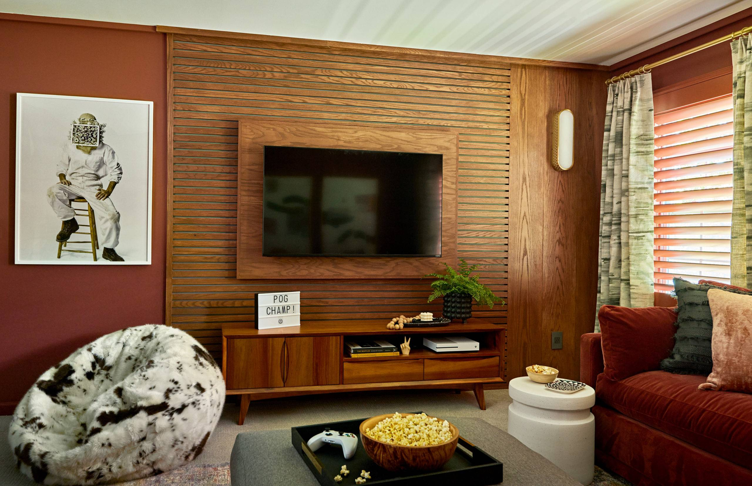 game room with wooden entertainment center and flat screen tv